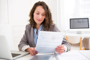 view of a Young attractive woman doing paperwork
